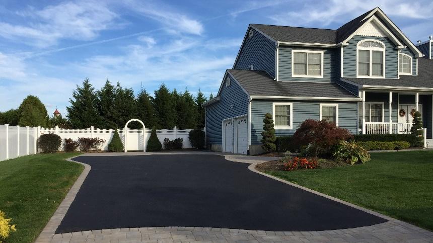 asphalt and brick paver driveway